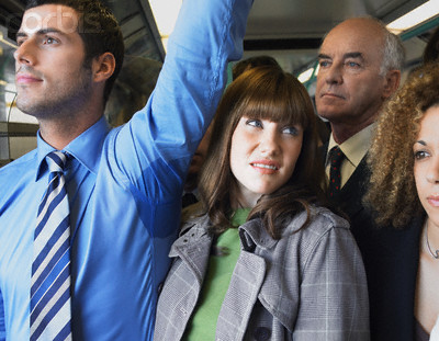 Commuter Standing by Man's Wet Armpit on Train